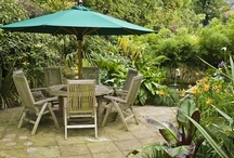 Holidays at Home / A small town garden in suburban Surrey becomes a tropical oasis with a pond, deck, seating areas and lush planting to evoke memories of exotic holidays abroad