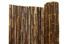 Bamboo Fencing / We use quality materials to ensure that each of our bamboo fencing rolls is made from the most durable cane available. Our many types of outdoor bamboo fencing are constructed using only Tonkin bamboo and have gone through rigorous quality control methods. Each fence panel is connected by a series of galvanized steel wires and capped on top for finished look. Our bamboo fencing comes individually bagged, ready for easy installation.