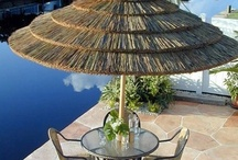 Tiki Huts and Palapas / This 7 foot diameter grass umbrella is completely collapsible and portable. The 1 3/4 inch diameter bamboo pole easily breaks down into 2 pieces for storage or is durable enough to be left up year round. The umbrella cover is made from real sea grass imported from around the world and hand-picked to ensure the highest possible quality. Sea grass and bamboo are considered renewable resources so you can achieve a natural island look without depleting natural resources.