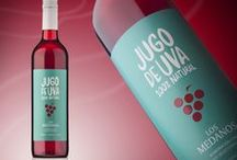 Jugo de Uva by Vinecol / Feast your eyes on this gorgeous bottle of natural grape juice designed by Caliptra for Vinecol.  The modern label is inspired by the organic style using green colours. The use of red for the grapes at the middle of the label creates a smart link with the colour of the juice.   Using modern typography and illustration with striking colours, the packaging has a young retro vintage style.