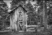 Outhouses, Dunnys, Loo's, Long-Drop, Privy's, Letrina's, Utedass's, Toilettenhauschen's / The outhouse originated about 500 years ago in Europe, and was used primarily at inns or in public spaces. During this time, the ubiquitous symbol of the crescent moon on the outhouse door also began to appear. Since most people were illiterate during this time, the male outhouses were marked with the symbol of a sun, indicating masculinity, and the women's were marked with a symbol of a crescent moon, which represented the feminine. / by Outhouse Collection