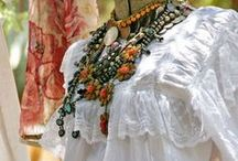 Fashion / Big chunky jewelry, gauzy or linen tops, flirty lace, headbands, scarves, stitched, embellished, we love it all.  We just love playing dress up.