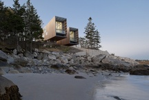 Two Hulls House / This project is situated in a glaciated, coastal landscape, with a cool maritime climate. The geomorphology of the site consists of granite bedrock and boulder till, creating pristine white sand beaches, and turquoise waters. The two pavilions float above the shoreline like two ship's hulls up on cradles for the winter, forming protected outdoor places both between and under them. A concrete seawall on the foreshore protects the house from rogue waves.
