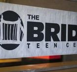 Behind The Scenes / The Bridge Teen Center opened its doors to the community in 2010 and busted through the brick wall and created The Garage during the Summer of 2011.