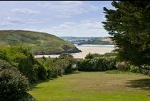 Puffins - a self-catering holiday cottage in Daymer Bay, North Cornwall by Latitude50. / Puffins has breathtaking views of the estuary from its generous, south-facing garden, while a nearby footpath leads to the golden sands of Daymer Bay.  Find out more here: http://www.latitude50.co.uk/our-cottages/daymer-bay-holiday-cottages/puffins