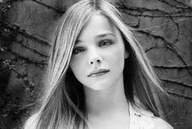 Chloë Grace Moretz / Chloë Grace Moretz was born in Atlanta, Georgia, USA, to Teri (Duke), a nurse, and McCoy Lee Moretz, a plastic surgeon. She has four brothers, all older. Her ancestry is mostly German and English.