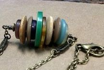 Jewelry with buttons