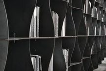 Iron-ic bookcase, wave after wave / Sinuous, versatile and textured, the Iron-ic bookcase features a natural iron modular architecture based on the snap-together assembly of each module's components.