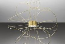 Hoops, dynamic and static in perfect balance / Orbits of gold by Axo Light - design Giovanni Barbato