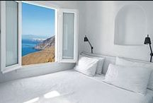 PETITE SUITE / Private balcony with outside seating facing the sea, the caldera and the volcano.