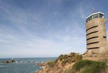 Radio Tower / Jersey Heritage self-catering Holiday Lets. Set on a cliff top overlooking Corbière lighthouse on Jersey's southwest tip, the Radio Tower is a striking observation tower built during the Second World War. Restored in the German modernist Bauhaus style, the tower is over six floors and boasts a 360-degree view from the panoramic windows in the lounge/diner.  Contact Jersey Heritage on heritagelets@jerseyheritage.org for further information.