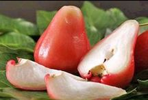 Rose apple / This fruit is guava shaped with a thin and waxy skin.  Its inner core is slightly fluffy & is native to East Indies and Malaya.  It is used in jellies and jams or preserved and is rich in vitamin C, dietary fibre, vitamin A, calcium, iron, sulphur, and potassium. Health benefits include detoxifing the liver, improve digestion, protect against diabetes, lower cholesterol, prevent certain types of cancers, reduce epileptic seizures etc.  For more info visit http://www.lifegivingfoods.org/