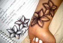 Tattoos & Peircings / by Amanda Spaid