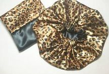Natural Hair Shop - Satin Bonnets / Silky smooth satin bonnets that protect natural hair's curls and coils while you sleep. Satin bonnets also help hair retain its moisture and prevents frizz.