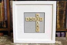 Scrabble pictures / Wooden letter scrabble tiles are used to create framed bespoke picture frames.