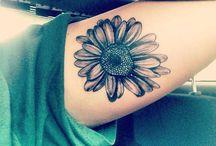 Tattoos & Piercings! / by hanna Braddy
