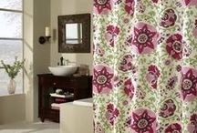 Colorful Shower Curtains / A colored shower curtain turns a plain, white bathroom into a page from a designer's portfolio.