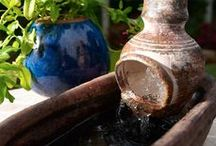 Container Fountains and Ponds / Containers such as barrels, urns, and tubs that are filled with water and used as lightweight, portable ponds for patios, decks, gardens, or balconies.