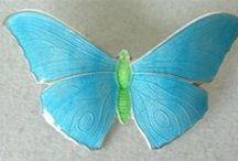 Enamel butterflies.