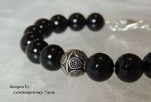 Black Onyx / Onyx gives strength. It promotes vigor, steadfastness and stamina. Imparts self-confidence, helping you to be at ease in your surroundings. Onyx banishes grief, enhances self-control and stimulates the power of wise decision-making. It encourages happiness and good fortune.  Follow me on Facebook at https://www.facebook.com/contemporarytara and ETSY at https://www.etsy.com/shop/ContemporaryTara?ref=search_shop_redirect