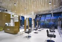 HOSPITALITY: Bomton Hairdressers, Prague / Light is wellbeing – Where else than at a place of beauty should the light be making you feel good? At Bomton hairdresser's in Prague 30 Sento sospesos in a sea of wooden grass create the right atmosphere to be pampered in. Photos: Filip Slapal