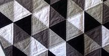 "Black & White - FoQ Challenge 2017 / Monochrome quilts and blankets.    For the first few days of their life babies can only see in black and white, so we are making this our theme for the year. We would like you to make a quilt 30"" square, in a geometric design, using only black and white fabric.  The finished quilt, or top, can be given to your local coordinator or, if preferred, handed over at the Festival of Quilts 2017."