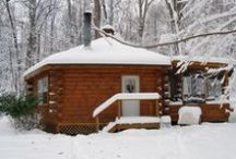 Phenix / Ole Mink Farm Recreation Resort's Phenix Luxury Log Cabin. This hexagonal 2 Bedroom Rental Cabin offers a touch of contemporary style, with a spacious living area featuring a large raised hearth stone fireplace.