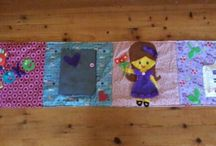 Roll up quiet books / These are my creations- roll up books / playmats for young kids to play with, using their imagination, developing fine motor skills with zips, buttons, velcro