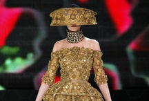 SPRING 2013 READY-TO-WEAR Alexander McQueen / Everything about bees was an endlessly rewarding inspiration for Sarah Burton's new Alexander McQueen collection. Forget the obvious—she has, after all, proved herself the McQueen Bee with a spectacular string of buzzy fashion coups.