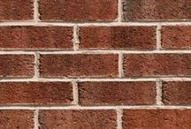 Bostonian Ironspot   Triangle Brick Company / When you look closely at Bostonian Ironspot brick, you'll notice a one-of-a-kind texture made from different sizes of iron-filled holes. By using an iron spotting process on this special production Triangle Brick Company Premium-tier product, we've enhanced the varieties of brown and red hues in this brick with a roughness that creates interest and individuality.