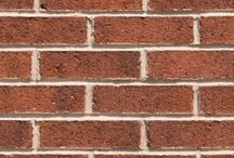Coventry Ironspot   Triangle Brick Company / Subtle flecks of iron in dark blues and blacks provide a unique look and feel to our Coventry Ironspot architectural brick, offered under Triangle Brick Company's Premium product tier. From far away, this rich red ironspot brick gives off an opulent, metallic-like appearance, making our special production Coventry Ironspot brick, as well as our other ironspot bricks, the perfect exterior cladding option for a wide range of commercial projects.