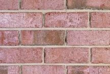 Augusta Rose   Triangle Brick Company / With a soft rose color evoking the pearly pink on the inside of a seashell, our special production Augusta Rose brick creates a look reminiscent of a quaint English seaside cottage. This gorgeous, textured brick features dark flashed highlights throughout in subtle browns and grays. The Augusta Rose is part of our Select tier, offering a superior level of quality our customers have come to expect from Triangle Brick Company.