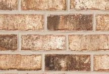 Oakton   Triangle Brick Company / This gorgeous multifaceted brick was designed with an artistic touch; bringing multiple colors together from nature into one single pallet.   This sand-faced tumbled brick features a blend of creamy white, tan, brown, and charcoal hues to leave you with a look that is dynamic and beautiful.  Use Triangle Brick Company's Premium-tier Oakton brick to showcase the exquisite craftsmanship of your project.