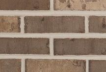 Georgetown   Triangle Brick Company / The combination of smooth and tumbled textures, along with the subtle gray color palette, including a range of cream and golden tones, makes the Georgetown a truly unique brick offering.  Easily paired with neutrals, warm tones, and anything in between; the Georgetown offers lasting appeal and functionality.
