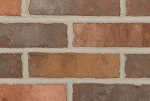Cimarron   Triangle Brick Company / The Cimarron, named after a river that stretches from New Mexico to Kansas is a gorgeous earth tone brick with highlights of warm gray, gold, and orange. The combination of highlight colors and the soft red base makes this color a clear choice for projects that stand apart from the rest. For added dimension, this brick has a tumbled texture introduces character and style to your brick offering.