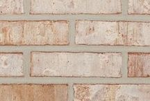 Cottonwood   Triangle Brick Company / The Cottonwood is the perfect neutral brick color - taking cues from nature with its subtle red background, creamy white tones, and gray highlights.  The smooth face texture combined with tumbled edges and dynamic layers of color will appeal to customers looking for a high-quality brick with a subtle yet powerful design aesthetic.