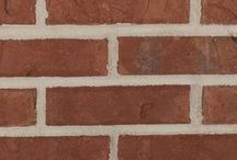 Franklin   Triangle Brick Company / The richly textured red body of the Franklin is complemented with tones of warm gray, gold and tan along with a slight iridescence of purple and blue. The unique color range of this tumbled brick makes it a versatile solution for residential and commercial applications.