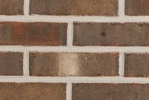 Hamilton Creek   Triangle Brick Company / The combination of smooth and tumbled textures, along with the warm gray, cream and plum tones makes the Hamilton Park a luxurious choice for most any project.   Easily paired with neutrals, warm tones, and anything in between; the Hamilton Creek will make an attractive pairing with most any color palette.