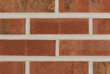 Kempton   Triangle Brick Company / The soft-red body of the Kempton is complemented with tones of warm gray, gold and tan along with a slight iridescence of purple and blue.  The subtle texture accentuates the color range of this brick making it a unique and versatile option for almost any project.