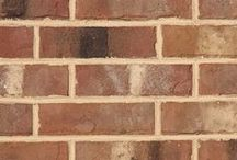 Old Henry   Triangle Brick Company / A tumbled texture adds character and depth to the Old Henry, featuring many of mother nature's best tones — browns, creams and burnt grays.  This color palette offers variety and versatility for almost any building project. No matter where your project is built this sand-faced brick will provide you with a superior exterior cladding option.