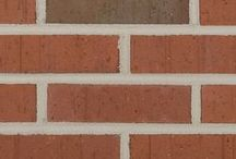 Texas Flashed Wirecut   Triangle Brick Company / Our Texas Flashed Wirecut brick is the quintessential architectural brick, featuring a classic red hue, textured finish, and light and dark flashed accents in shades of charcoal for an appearance that feels both urban and organic. Wirecutting helps give this architectural brick its sharp, distinct edges, providing a contemporary, streamlined look for whatever commercial building project you may be planning, from restaurants to storefronts and everything in between.
