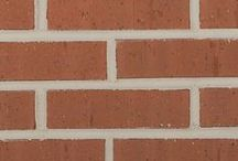 Texas Red Wirecut   Triangle Brick Company / Help your commercial building stand the test of time in both durability and style with the Standard-tier Red Wirecut brick from Triangle Brick Company. This classic red brick offers a timeless look for a wide range of commercial building applications. The semi-smooth wirecut texture complements almost any building material or design element.