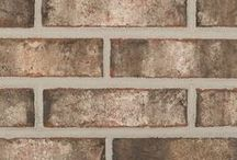 Grayson   Triangle Brick Company / Grayson reminds us of an early morning in the desert mountains, when the smoke is beginning to clear from the horizon. From its creamy grays to its strong, charcoal accents, this brick has an extremely bold, yet has an intricate distinction to it. At first glance, we notice the cool tones, but when looking deeper into this brick, it also provides a warm feel. Grayson's many shades of gray would pair splendidly with any exterior color scheme project.