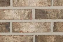 Porter   Triangle Brick Company / From the Gulf Coastal region, Porter provides a relaxing look with both a warm and cool colors. Porter demonstrates a more modern take with its gray and charcoal intertwined with creamy whites, all accented with smoky hues. Create a relaxing refined look by adding Porter to your next project.