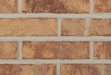 Whitney   Triangle Brick Company / The combination of smooth and tumbled textures highlight the warm tan, creamy white, maroon, and soft gray tones of this brick. The soft-red base color is revealed for added interest and depth. If you're looking for a high-quality brick with a dynamic color palette, the Whitney is for you! Easily paired with neutrals, warm tones, and anything in between; the Whitney is a brick with tons of versatility and will be well-suited for most any project.
