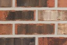 Nocona   Triangle Brick Company / Resembling the rich colors of the Red River, the Nocona is a vibrant and lively brick. We love the sophistication of the color palette combined with the rich texture of this brick.   With a bold orange-red base, the subtle creams and charcoal flashing add amazing character to this brick. Looking for a classic and timeless color palette? The Nocona would be a great selection for any project.