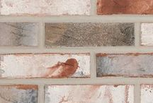 Grand Isle   Triangle Brick Company / The Grand Isle is its own hidden oasis, much like the town the brick is named after. This brick is composed of beautiful colors varying from creamy whites to light grays, with hints of blue and red. With its weathered, Gulf coast beach appearance, Grand Isle can provide a very calm, cool look to any project.