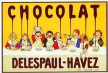 La strada di cioccolato / ... Era cioccolato, era una strada di cioccolato. Cominciarono a mangiare un pezzetto, poi un altro pezzetto, venne la sera e i tre fratellini erano ancora lì che mangiavano la strada di cioccolato, finchè non ce ne fu più neanche un quadratino. Non c'era più nè il cioccolato nè la strada.  Da: I cinque libri, di Gianni Rodari