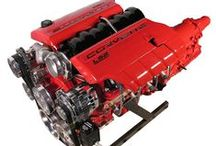 Corvette Red LS2 Engine with 4L65E Transmission / Custom LS2 Engine with 400 Horse Power. Bright Corvette Red painted engine, transmission, oil pan, timing cover, water pump, and injector covers. Fitted with a Billet Aluminum Serpentine System for Hot Rod applications. Are you looking for something special for your Hot Rod? Check us out at spsengines.com.