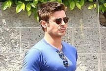 Zac on Monday afternoon (March 31/14) in Hollywood. / Zac Efron leaves a restaurant wearing a tight blue t-shirt after having lunch with a mystery gal on Monday afternoon (March 31) in Hollywood.  The 26-year-old actor was seen earlier in the afternoon arriving at the restaurant wearing a Neil Young tour shirt. We sure love the tight tee look on Zac and hopes he always wears clothes that fit that way!